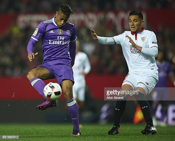 Mariano Diaz of Real Madrid CF being followed by Matias Kranevitter of Sevilla FC during the Copa del Rey Round of 16 Second Leg match between...