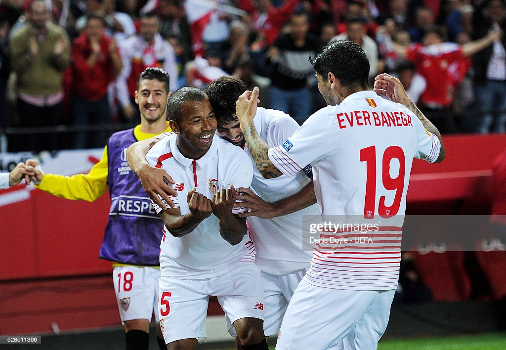 Mariano Ferreira of Sevilla FC celebrates with Ever Banega after scoring his team's 3rd goal during the UEFA Europa League Semi Final second leg match between Sevilla and Shakhtar Donetsk at the Sanchez Pizjuan stadium on May 5, 2016 in Seville, Spain.