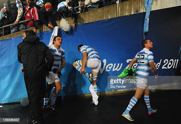 Mariano Galarza of Argentina removes his shorts to give them to a fan following his team's 1312 victory during the IRB 2011 Rugby World Cup Pool B...