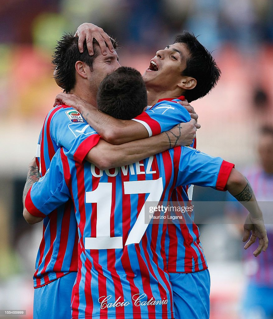 Mariano Izco (L), Alejandro Gomez (C) and Pablo Barrientos of Catania celebrate the third goal during the Serie A match between Calcio Catania and S.S. Lazio at Stadio Angelo Massimino on November 4, 2012 in Catania, Italy.