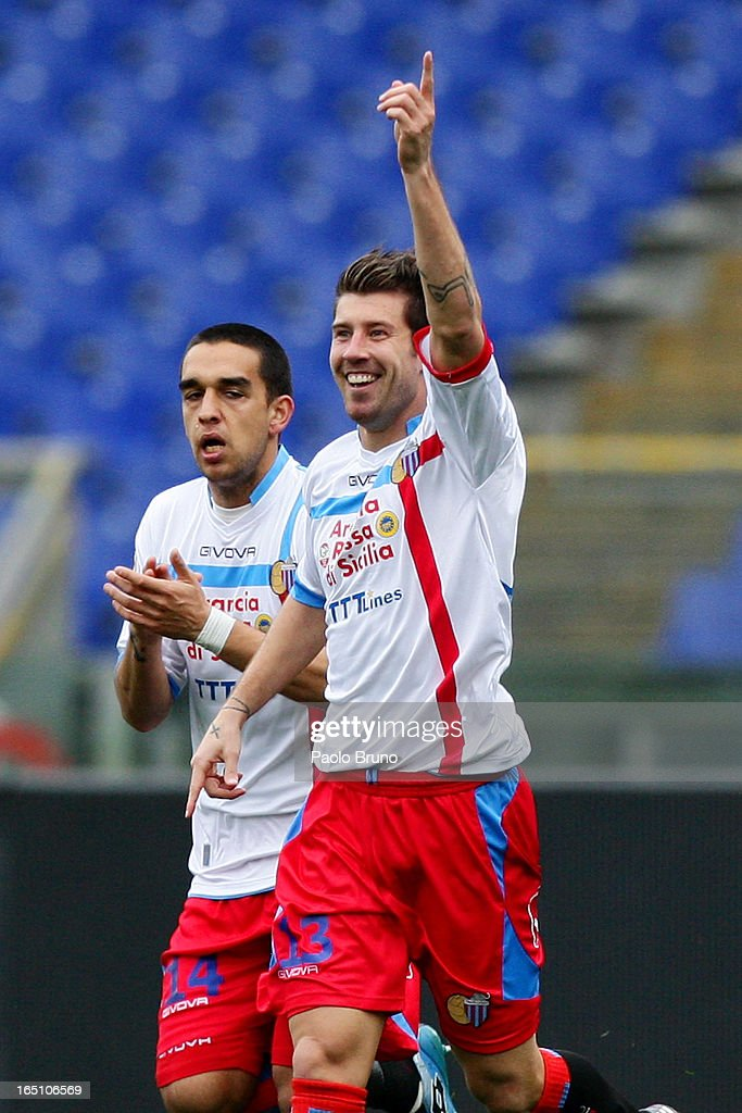 Mariano Izco (R) of Calcio Catania celebrates with Adrian Ricchiuti after scoring the opening goal during the Serie A match between S.S. Lazio and Calcio Catania at Stadio Olimpico on March 30, 2013 in Rome, Italy.