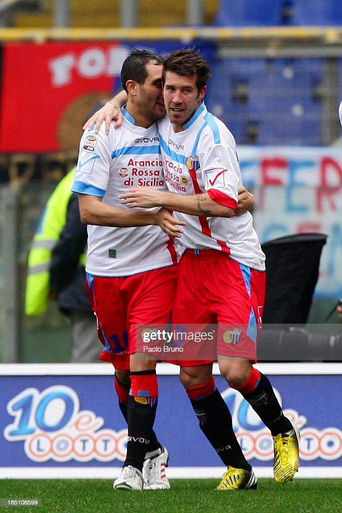 Mariano Izco (R) of Calcio Catania celebrates with Francesco Lodi after scoring the opening goal during the Serie A match between S.S. Lazio and Calcio Catania at Stadio Olimpico on March 30, 2013 in Rome, Italy.