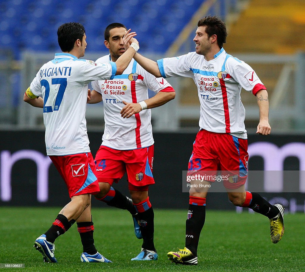 Mariano Izco (R) of Calcio Catania celebrates with of Adrian Riccchiuti and Marco Biaganti (L) after scoring the opening goal during the Serie A match between S.S. Lazio and Calcio Catania at Stadio Olimpico on March 30, 2013 in Rome, Italy.