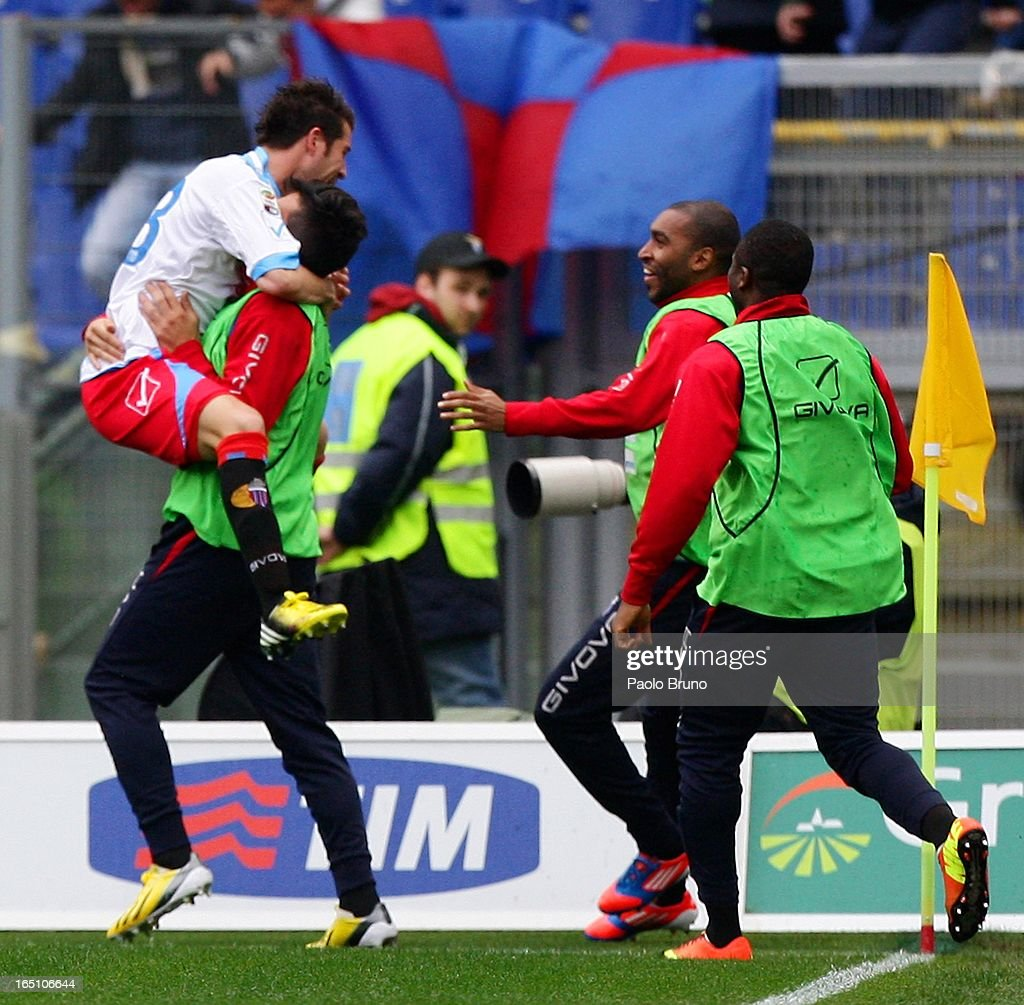 Mariano Izco (L) of Calcio Catania celebrates with team-mates after scoring the opening goal during the Serie A match between S.S. Lazio and Calcio Catania at Stadio Olimpico on March 30, 2013 in Rome, Italy.