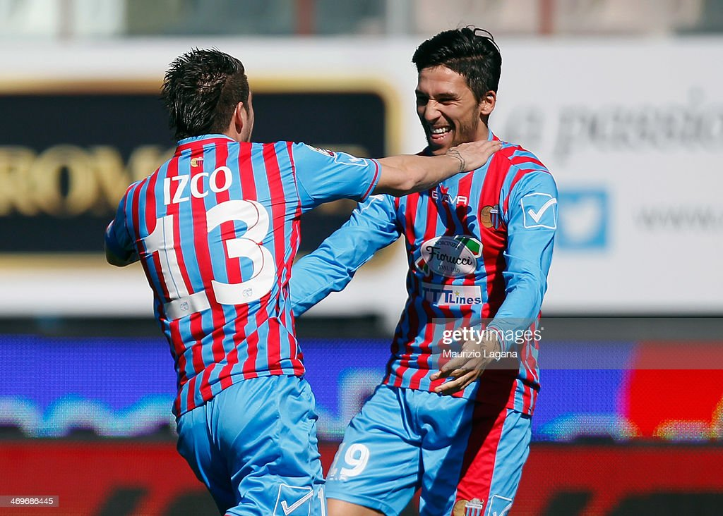Mariano Izco of Catania celebrates the opening goal with his teammate Lucas Castro during the Serie A match between Calcio Catania and SS Lazio at...