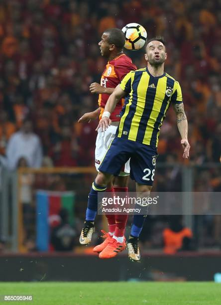 Mariano of Galatasaray in action against Mathieu Valbuena of Fenerbahce during a Turkish Super Lig match between Galatasaray and Fenerbahce at Ali...