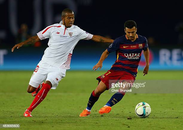 Mariano of Sevilla marshalls Pedro of Barcelona during the UEFA Super Cup between Barcelona and Sevilla FC at Dinamo Arena on August 11 2015 in...