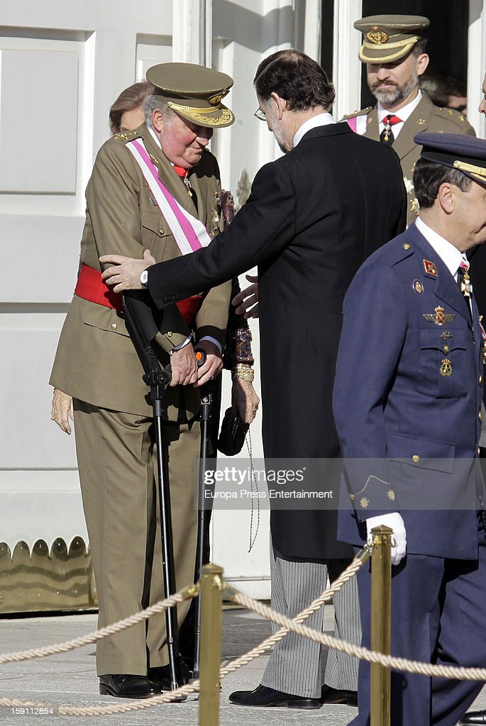 Mariano Rajoy (2L) and King <a gi-track='captionPersonalityLinkClicked' href=/galleries/search?phrase=Juan+Carlos+I&family=editorial&specificpeople=159452 ng-click='$event.stopPropagation()'>Juan Carlos I</a> of Spain (L) attend the New Year's Military Parade on January 6, 2013 in Madrid, Spain.