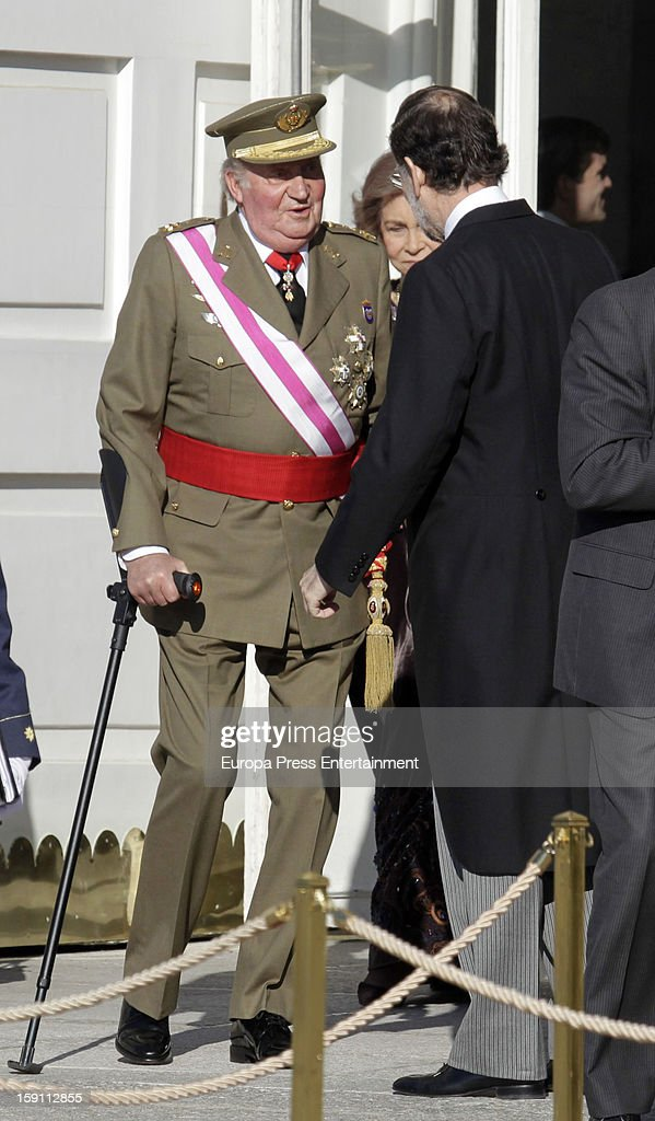 Mariano Rajoy (2L) and King Juan Carlos I of Spain (L) attend the New Year's Military Parade on January 6, 2013 in Madrid, Spain.
