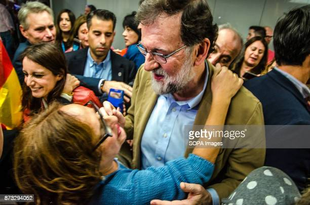Mariano Rajoy is embraced by a supporter of the Popular Party The Popular Party of Catalonia has counted with the presence of the Spanish President...