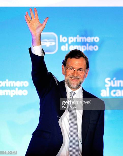 Mariano Rajoy leader of the Popular Party and Spanish Prime Minister elect waves from the balcony of party headquarters after winning the Spanish...