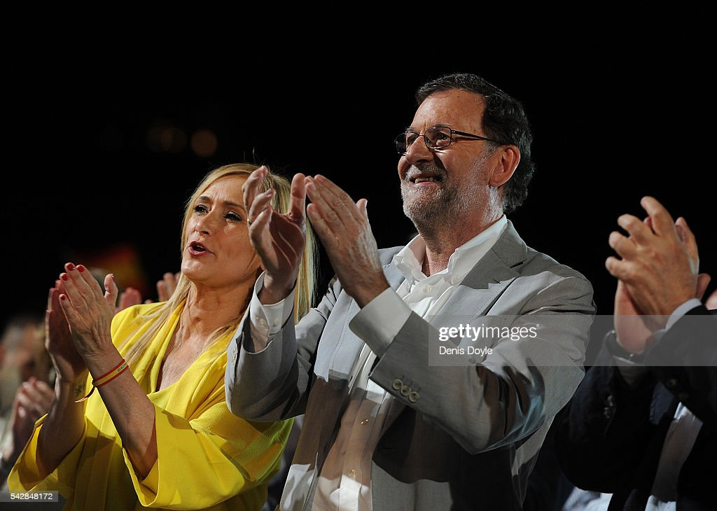 Mariano Rajoy, Spain's acting Prime Minister of the caretaker government and <a gi-track='captionPersonalityLinkClicked' href=/galleries/search?phrase=Cristina+Cifuentes&family=editorial&specificpeople=9456295 ng-click='$event.stopPropagation()'>Cristina Cifuentes</a>, President of the Regional Government of Madrid applaud during the closing rally ahead of Spanish General Elections on June 24, 2016 in Madrid, Spain. Spanish voters head back to the polls on June 26 after the last election in December failed to produce a government. Latest opinion polls suggest the Unidos Podemos left-wing alliance could make enough gains to come in second behind the caretaker government of the center-right Popular Party.