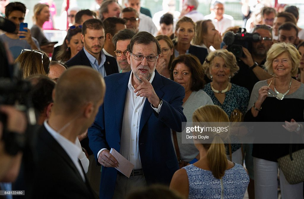 Mariano Rajoy, Spain's acting Prime Minister of the caretaker government, arrives at a polling booth to cast his vote for the Spanish general election on June 26, 2016 in Madrid, Spain. Spanish voters head back to the polls on June 26 after the last election in December failed to produce a government. Latest opinion polls suggest the Unidos Podemos left-wing alliance could make enough gains to come in second behind the caretaker government of the center-right Popular Party.