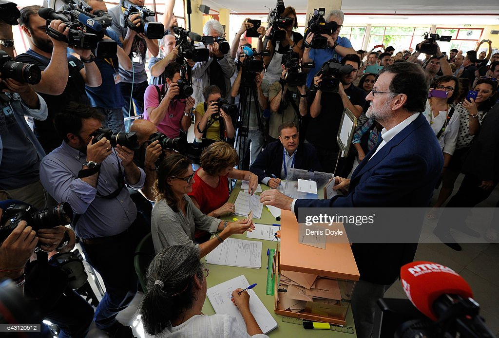 Mariano Rajoy, Spain's acting Prime Minister of the caretaker government, casts his vote for the Spanish general election on June 26, 2016 in Madrid, Spain. Spanish voters head back to the polls on June 26 after the last election in December failed to produce a government. Latest opinion polls suggest the Unidos Podemos left-wing alliance could make enough gains to come in second behind the caretaker government of the center-right Popular Party.