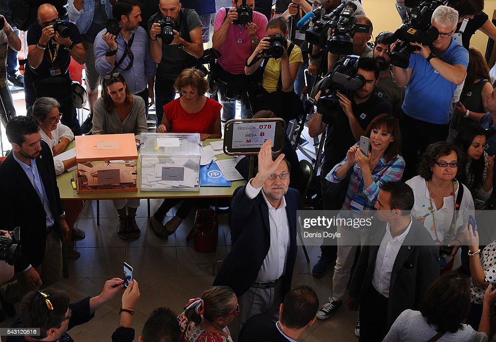 Mariano Rajoy, Spain's acting Prime Minister of the caretaker government, waves after casting his vote for the Spanish general election on June 26, 2016 in Madrid, Spain. Spanish voters head back to the polls on June 26 after the last election in December failed to produce a government. Latest opinion polls suggest the Unidos Podemos left-wing alliance could make enough gains to come in second behind the caretaker government of the center-right Popular Party.