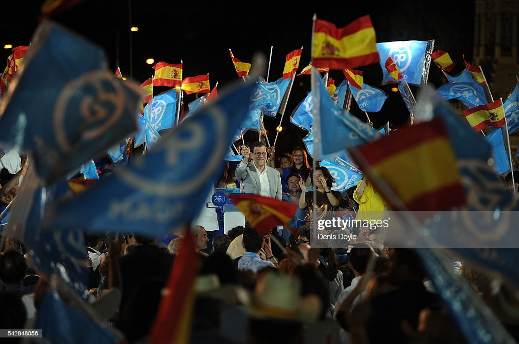 Mariano Rajoy, Spain's acting Prime Minister of the caretaker government waves to Popular Party supporters during the closing rally ahead of Spanish General Elections on June 24, 2016 in Madrid, Spain. Spanish voters head back to the polls on June 26 after the last election in December failed to produce a government. Latest opinion polls suggest the Unidos Podemos left-wing alliance could make enough gains to come in second behind the caretaker government of the center-right Popular Party.