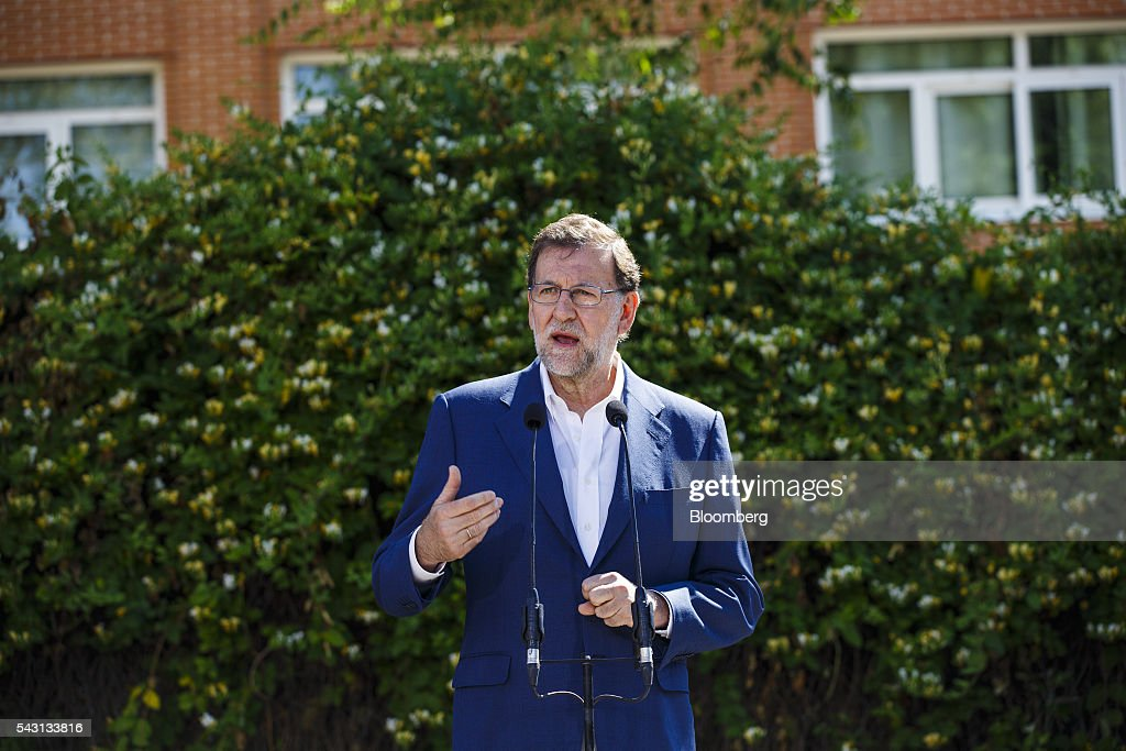 Mariano Rajoy, Spain's acting Prime Minister, speaks to members of the media after casting his vote in the Spanish general election in Madrid, Spain, on Sunday, June 26, 2016. Spaniards began voting on Sunday in the second election in six months as the U.K. decision to leave the European Union adds to the uncertainty as the nation seeks to break a political deadlock. Photographer: Angel Navarrete/Bloomberg via Getty Images
