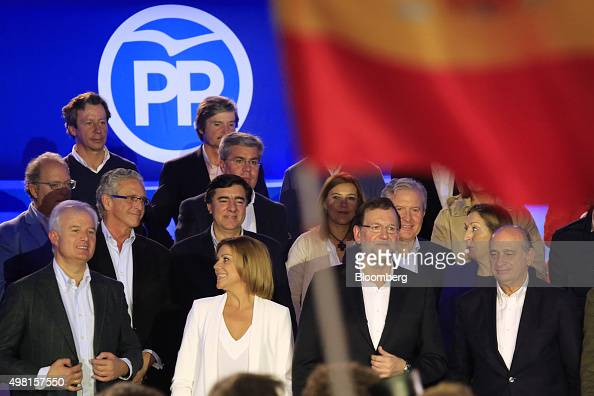Mariano Rajoy Spain's prime minister and leader of the Popular Party third from left with members of the party Maria Dolores de Cospedal...
