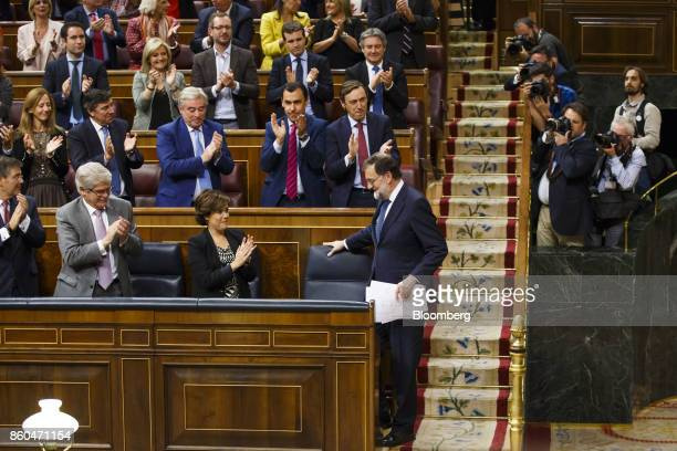 Mariano Rajoy Spain's prime minister bottom right receives applause from members of the People's Party following his speech at the parliament in...