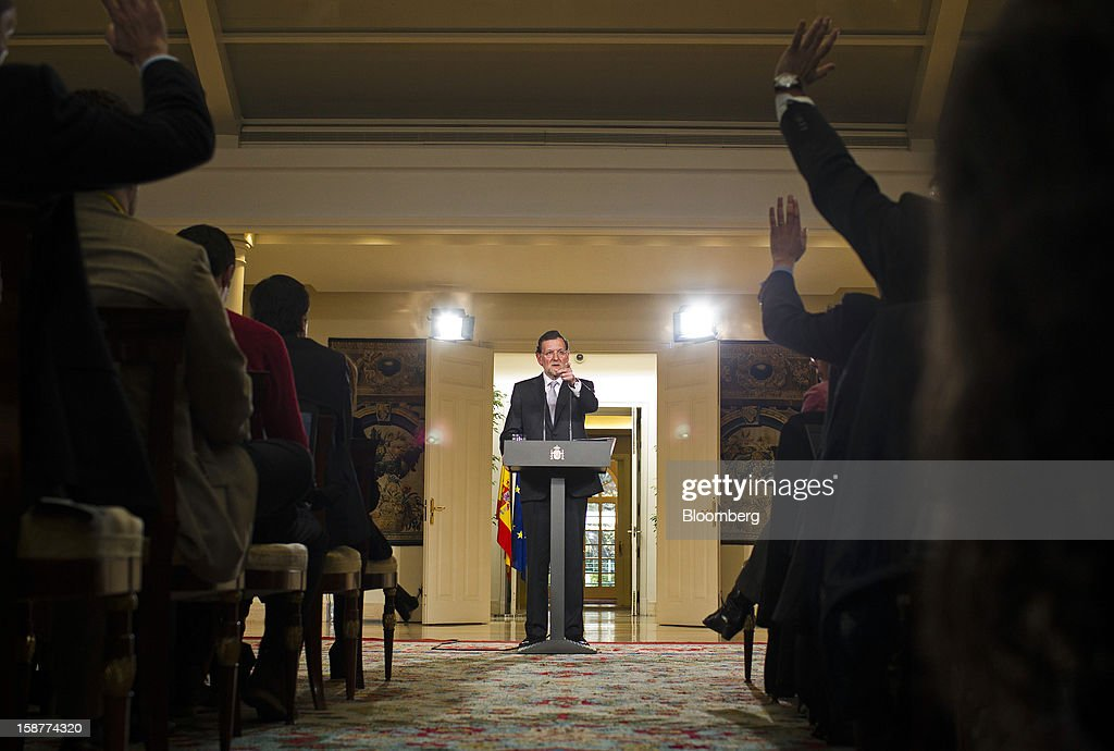 Mariano Rajoy, Spain's prime minister, center, gestures during a news conference at Moncloa palace in Madrid, Spain, on Friday, Dec. 28, 2012. Rajoy said 2013 will be 'very tough' amid the sixth year of an economic slump. Photographer: Angel Navarrete/Bloomberg via Getty Images