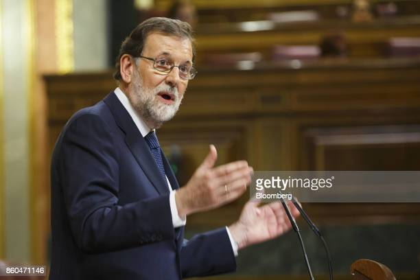 Mariano Rajoy Spain's prime minister gestures as he speaks at the parliament in Madrid Spain on Wednesday Oct 11 2017 Rajoy speaking after an...