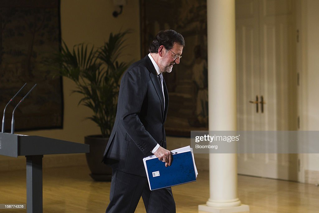 Mariano Rajoy, Spain's prime minister, leaves after a news conference at Moncloa palace in Madrid, Spain, on Friday, Dec. 28, 2012. Rajoy said 2013 will be 'very tough' amid the sixth year of an economic slump. Photographer: Angel Navarrete/Bloomberg via Getty Images