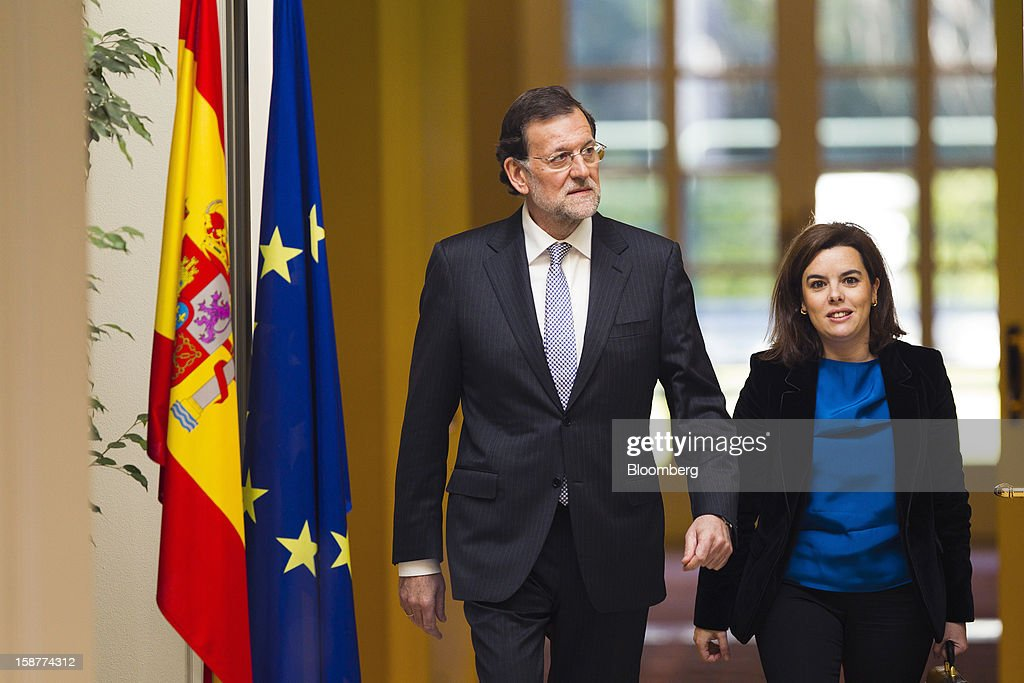 Mariano Rajoy, Spain's prime minister, left, and <a gi-track='captionPersonalityLinkClicked' href=/galleries/search?phrase=Soraya+Saenz+de+Santamaria&family=editorial&specificpeople=5131705 ng-click='$event.stopPropagation()'>Soraya Saenz de Santamaria</a>, Spain's deputy prime minister, arrive to attend a news conference at Moncloa palace in Madrid, Spain, on Friday, Dec. 28, 2012. Rajoy said 2013 will be 'very tough' amid the sixth year of an economic slump. Photographer: Angel Navarrete/Bloomberg via Getty Images