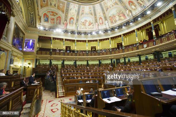 Mariano Rajoy Spain's prime minister left speaks at the parliament in Madrid Spain on Wednesday Oct 11 2017 Rajoy speaking after an emergency session...