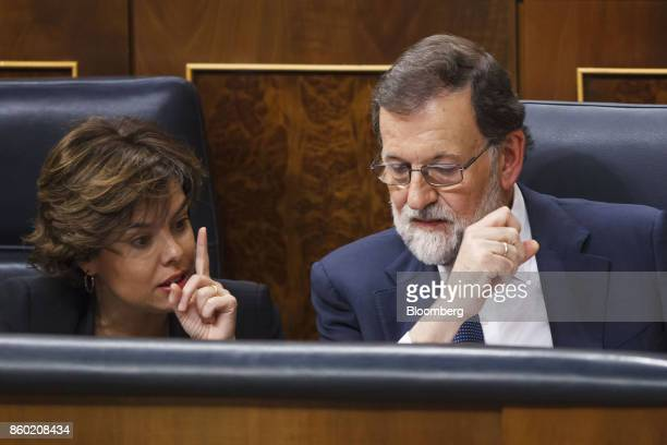 Mariano Rajoy Spain's prime minister right and Soraya Saenz de Santamaria Spain's deputy prime minister speak during a session at the parliament in...