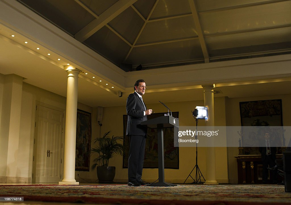 Mariano Rajoy, Spain's prime minister, speaks during a news conference at Moncloa palace in Madrid, Spain, on Friday, Dec. 28, 2012. Rajoy said 2013 will be 'very tough' amid the sixth year of an economic slump. Photographer: Angel Navarrete/Bloomberg via Getty Images