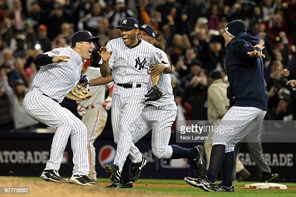 Mariano Rivera and Mark Teixeira of the New York Yankees celebrates after their 73 win against the Philadelphia Phillies in Game Six of the 2009 MLB...