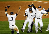 Mariano Rivera and Mark Teixeira of the New York Yankees runs towards Alex Rodriguez and his teammates as they celebrate after their 73 win against...