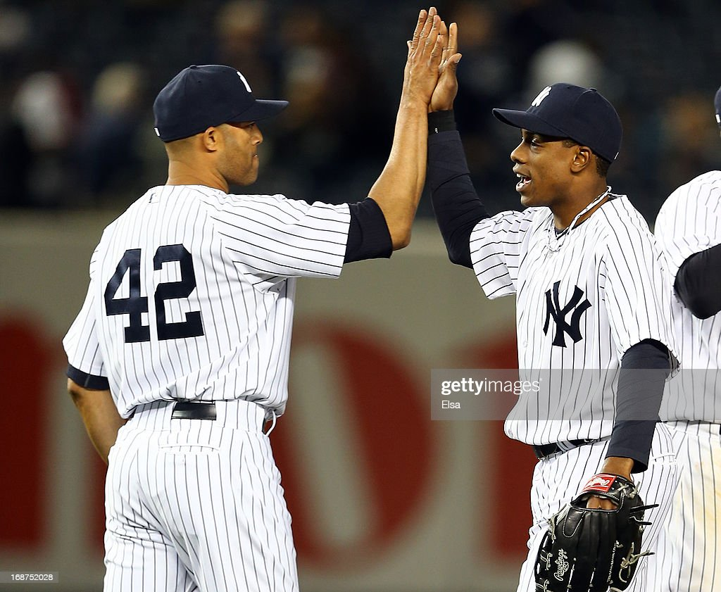 Mariano Rivera #42 celebrates the win with teammate Curtis Granderson #14 of the New York Yankees after the game against the Seattle Mariners on May 14, 2013 at Yankee Stadium in the Bronx borough of New York City.The New York Yankees defeated the Seattle Mariners 4-3.