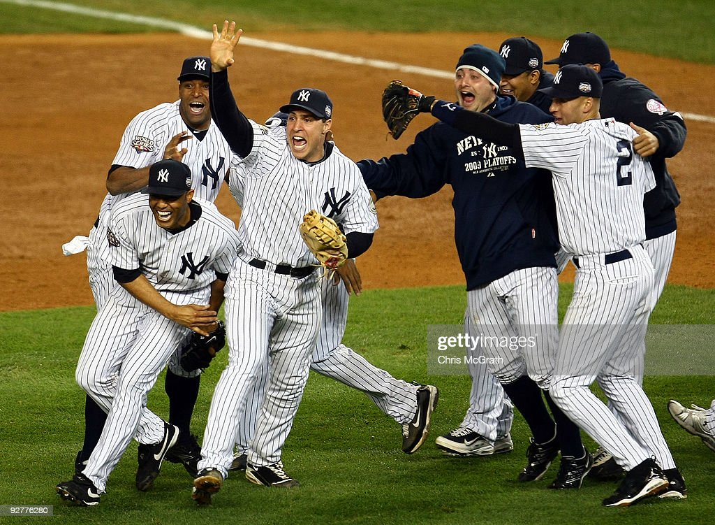 Mariano Rivera Mark Teixeira and Derek Jeter of the New York Yankees celebrate with teammates after their 73 win against the Philadelphia Phillies in...