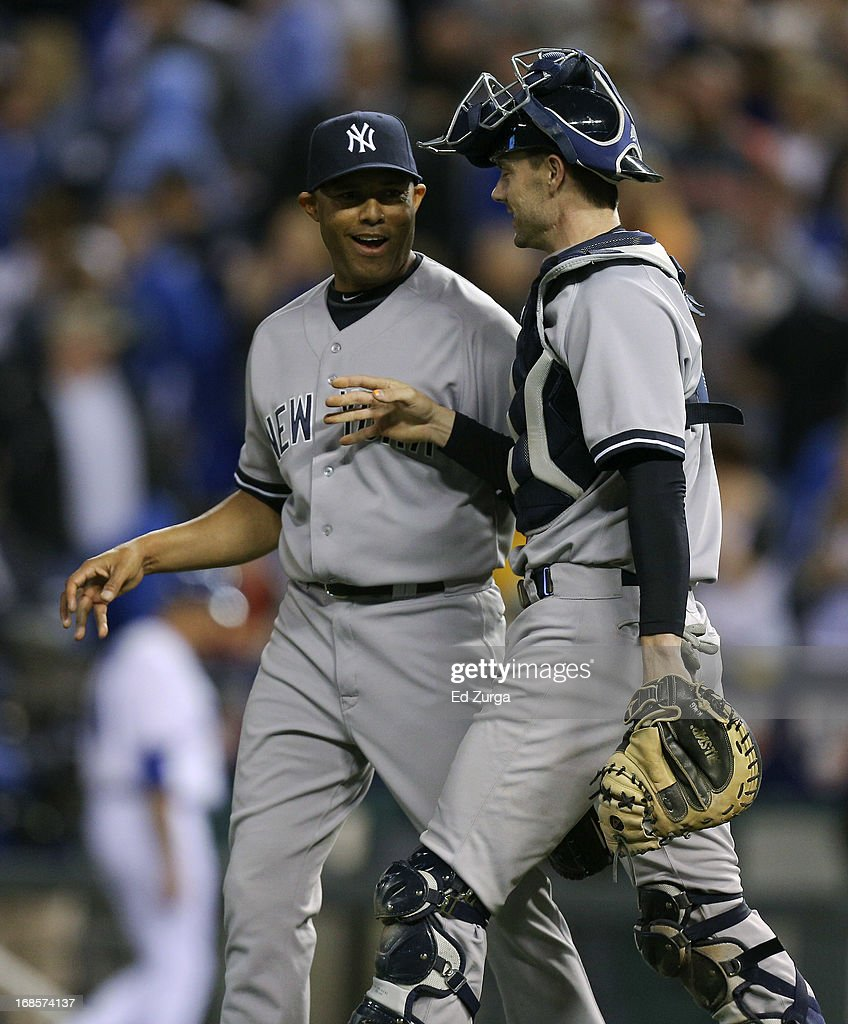 <a gi-track='captionPersonalityLinkClicked' href=/galleries/search?phrase=Mariano+Rivera&family=editorial&specificpeople=201607 ng-click='$event.stopPropagation()'>Mariano Rivera</a> #42 of the New York Yankees and Chris Stewart celebrate a win over the Kansas City Royals at Kauffman Stadium on May 11, 2013 in Kansas City, Missouri.
