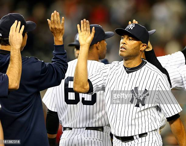 Mariano Rivera of the New York Yankees celebrates after the game against the San Francisco Giants during interleague play on September 20 2013 at...