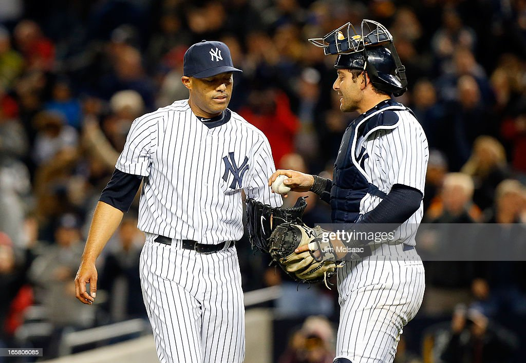 Mariano Rivera #42 of the New York Yankees celebrates his save against the Boston Red Sox with teammate Francisco Cervelli #29 at Yankee Stadium on April 4, 2013 in the Bronx borough of New York City. The Yankees defeated the Red Sox 4-2.