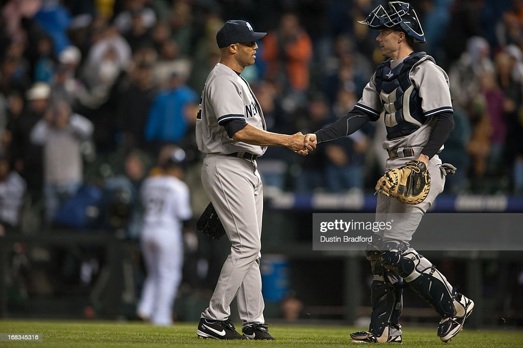 <a gi-track='captionPersonalityLinkClicked' href=/galleries/search?phrase=Mariano+Rivera&family=editorial&specificpeople=201607 ng-click='$event.stopPropagation()'>Mariano Rivera</a> #42 of the New York Yankees celebrates the win with Chris Stewart #19 of the New York Yankees after pitching the ninth inning of a game against the Colorado Rockies at Coors Field on May 8, 2013 in Denver, Colorado. The Yankees beat the Rockies 3-2.