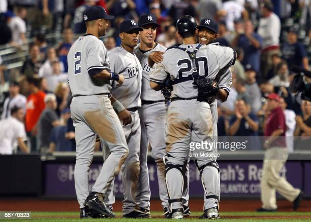 Mariano Rivera of the New York Yankees celebrates with teammates Jorge Posada Mark Teixeira Robinson Cano and Derek Jeter after the final out against...