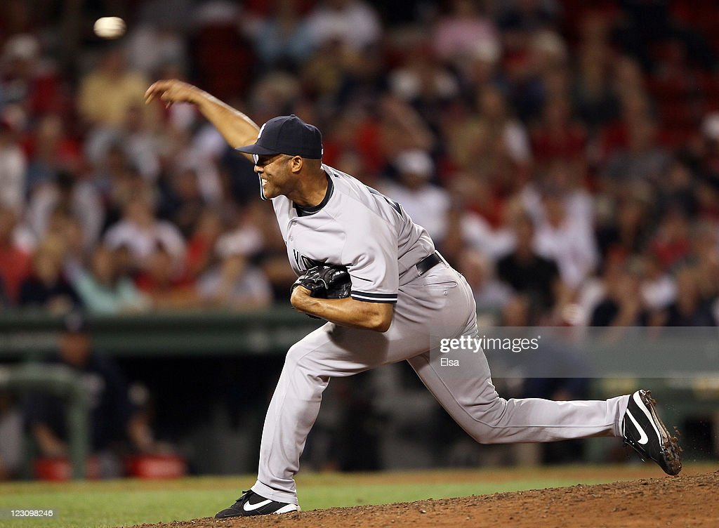 <a gi-track='captionPersonalityLinkClicked' href=/galleries/search?phrase=Mariano+Rivera&family=editorial&specificpeople=201607 ng-click='$event.stopPropagation()'>Mariano Rivera</a> #42 of the New York Yankees delivers a pitch in the ninth inning against the Boston Red Sox on August 30, 2011 at Fenway Park in Boston, Massachusetts.