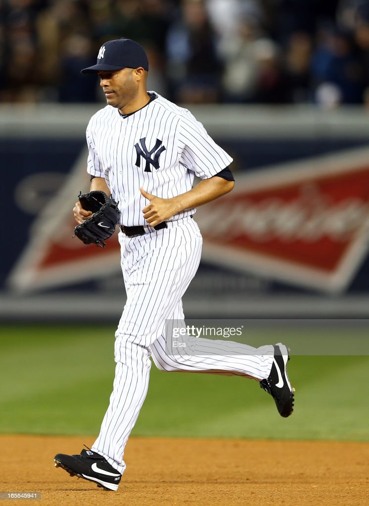 <a gi-track='captionPersonalityLinkClicked' href=/galleries/search?phrase=Mariano+Rivera&family=editorial&specificpeople=201607 ng-click='$event.stopPropagation()'>Mariano Rivera</a> #42 of the New York Yankees enters the game in the ninth inning against the Boston Red Sox on April 4, 2013 at Yankee Stadium in the Bronx borough of New York City.The New York Yankees defeated the Boston Red Sox 4-2.