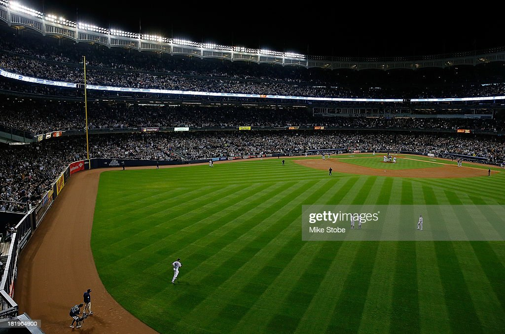 <a gi-track='captionPersonalityLinkClicked' href=/galleries/search?phrase=Mariano+Rivera&family=editorial&specificpeople=201607 ng-click='$event.stopPropagation()'>Mariano Rivera</a> #42 of the New York Yankees enters the game to pitch for the final time at Yankee Stadium against the Tampa Bay Rays in the eighth inning at Yankee Stadium on September 26, 2013 in the Bronx borough of New York City.