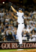 Mariano Rivera of the New York Yankees fields a hit in the ninth inning against the Tampa Bay Rays on September 26 2013 at Yankee Stadium in the...