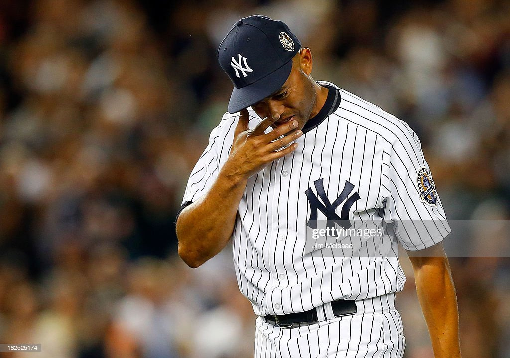 <a gi-track='captionPersonalityLinkClicked' href=/galleries/search?phrase=Mariano+Rivera&family=editorial&specificpeople=201607 ng-click='$event.stopPropagation()'>Mariano Rivera</a> #42 of the New York Yankees fights back tears as he is removed from a game against the Tampa Bay Rays in the ninth inning at Yankee Stadium on September 26, 2013 in the Bronx borough of New York City. The Rays defeated the Yankees 4-0.