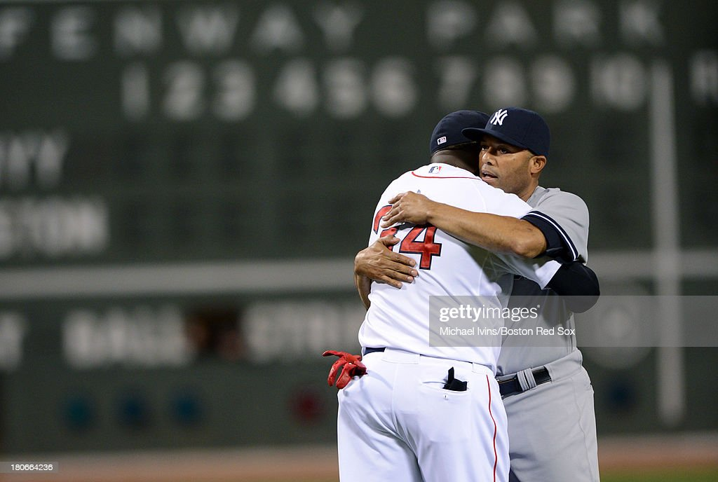 Mariano Rivera #42 of the New York Yankees hugs David Ortiz #34 after being honored during a pre game ceremony on September 15, 2013 at Fenway Park in Boston Massachusetts.