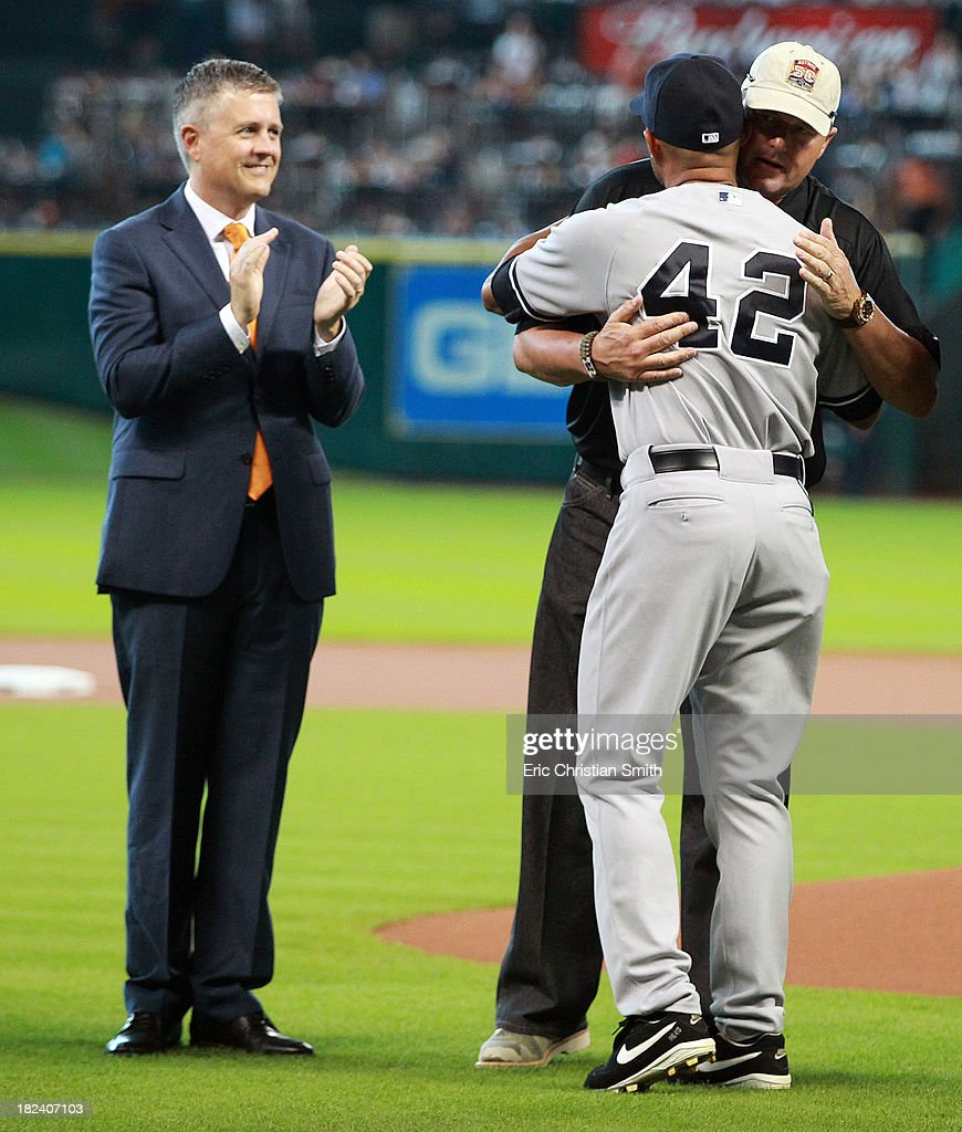 Mariano Rivera #42 of the New York Yankees hugs Roger Clemens as Houston Astros general manager Jeff Luhnow looks on before a game against the Houston Astros on September 29, 2013 at Minute Maid Park in Houston, TX.