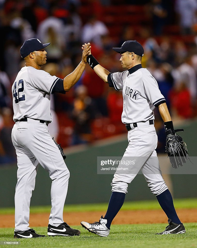Mariano Rivera #42 of the New York Yankees is congratulated by Ichiro Suzuki #31 of the New York Yankees following their win against the Boston Red Sox during the game on August 19, 2013 at Fenway Park in Boston, Massachusetts.