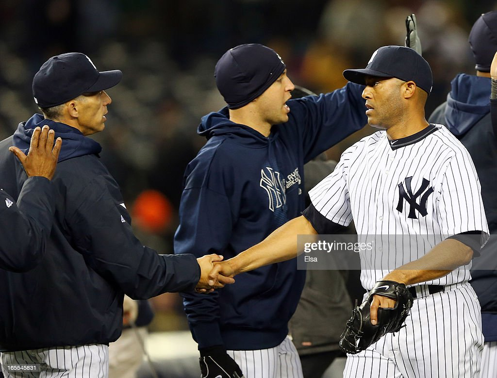 Mariano Rivera #42 of the New York Yankees is congratulated by manager Joe Girardi #28 after the win over the Boston Red Sox on April 4, 2013 at Yankee Stadium in the Bronx borough of New York City.The New York Yankees defeated the Boston Red Sox 4-2.