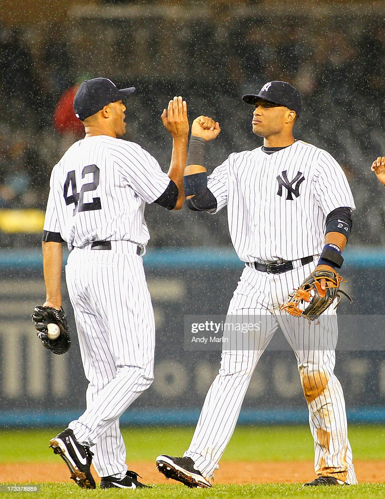 <a gi-track='captionPersonalityLinkClicked' href=/galleries/search?phrase=Mariano+Rivera&family=editorial&specificpeople=201607 ng-click='$event.stopPropagation()'>Mariano Rivera</a> #42 of the New York Yankees is congratulated by <a gi-track='captionPersonalityLinkClicked' href=/galleries/search?phrase=Robinson+Cano&family=editorial&specificpeople=538362 ng-click='$event.stopPropagation()'>Robinson Cano</a> #24 after Rivera saved the game against the Minnesota Twins at Yankee Stadium on July 12, 2013 in the Bronx borough of New York City.