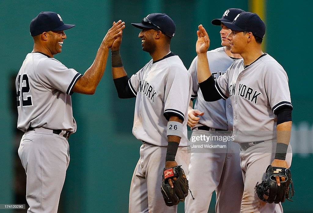 <a gi-track='captionPersonalityLinkClicked' href=/galleries/search?phrase=Mariano+Rivera&family=editorial&specificpeople=201607 ng-click='$event.stopPropagation()'>Mariano Rivera</a> #42 of the New York Yankees is congratulated by teammates after closing out a 5-2 win against the Boston Red Sox during the game on July 20, 2013 at Fenway Park in Boston, Massachusetts.
